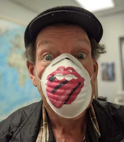 masked man with rolling stones emblem